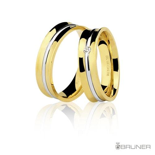 Aliança feminina em ouro com diamante.