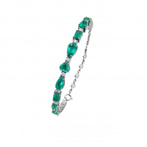 Bracelete em ouro branco com esmeraldas e diamantes.